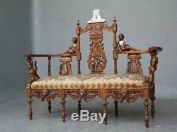 Banquette bois sculpté aux putti époque XIXème