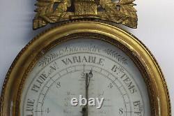 Baromètre ovale Epoque XIX eme en bois doré décor de panier fleuri FOULON Paris