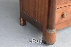 Commode à colonnes détachées en noyer d'époque Empire XIXème