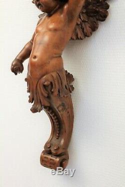 Console d'applique en bois sculpté représentant un ange époque XIX ème siècle