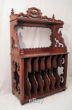 Etagère meuble à musique à suspendre en acajou époque XIX ème siècle