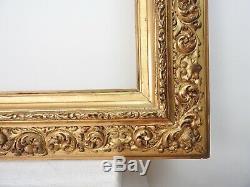 Grand cadre bois et stuc doré de style italien époque XIXème, monté à clefs 1/2