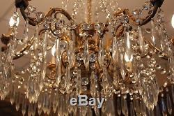 Grand lustre en bronze doré et cristal style Louis XVI époque XIX ème siècle