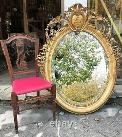 Grand miroir ovale en bois et stuck doré époque XIX ème siècle