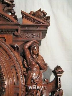 Grande pendule cartel en bois sculpté époque XIX ème siècle