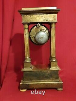 Horloge en bronze doré époque Empire XIX ème s