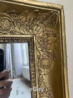 Magnifique miroir époque Empire en bois doré XIX Eme