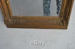 Miroir ancien en bois et stuc bronziné d'époque fin XIXème