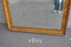 Miroir ancien en bois et stuc doré d'époque fin XIXème