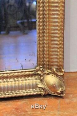 Miroir doré rectangulaire en bois et stuc époque XIX ème siècle