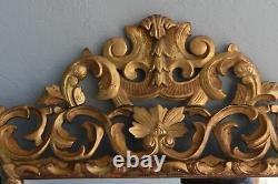 Miroir italien de style rocaille en bois doré d'époque XIXème