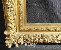 N° 658 CADRE Epoque XIXème en bois doré pour chassis 66,5 x 51 cm