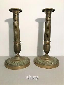 Paire de bougeoirs en bronze époque Restauration XIXème siècle