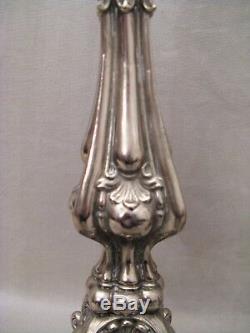 Paire de chandeliers d'église métal argenté époque XIX ème siècle