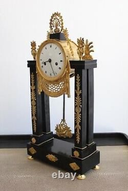 Pendule d'Epoque XIXème en Bronze doré