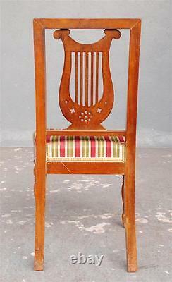Série huit chaises Restauration à la lyre époque XIXème