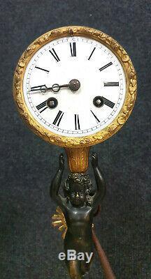 Superbe pendule au Putto époque XIXeme en bronze doré et patiné